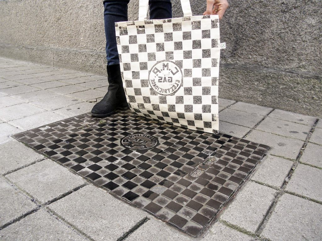 A picture of a bag being printed straight from a manhole cover in Porto.